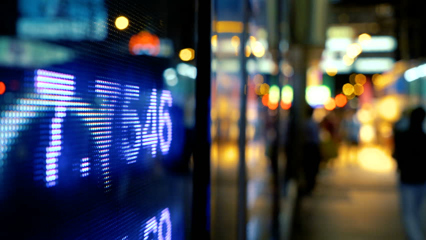Display of Stock market quotes with city scene reflect on glass | Shutterstock HD Video #27479143