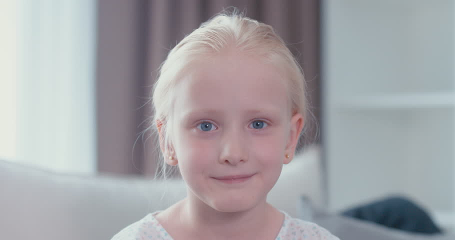 Cute little girl looking and smiling at the camera 4k uhd raw edited footage