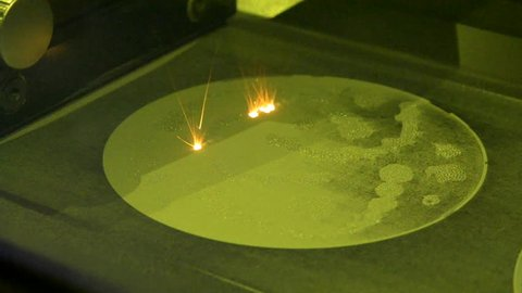 Laser sintering machine for metal. Metal is sintered under the action of laser into desired shape in working chamber. 3D printer printing metal. Modern additive technologies 4.0 industrial revolution