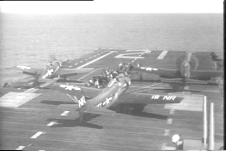 1940s: Grumman F6F Hellcat warplanes take off from the USS Boxer aircraft carrier and launch a guided missile, during the Korean War.