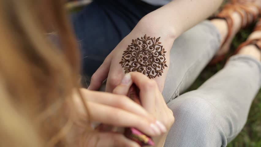 Mehndi Tattoo Hd : Hand of young caucasian woman with floral mehndi tattoo. close up