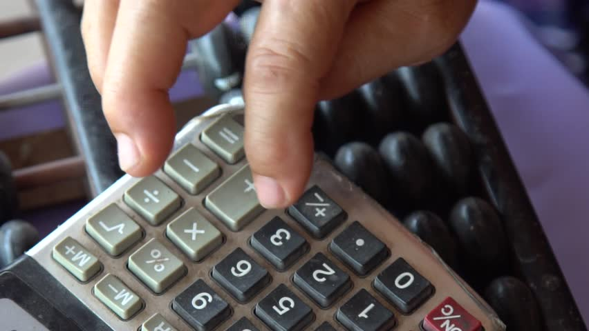 Slow motion : Old woman handle using calculator and abacus
