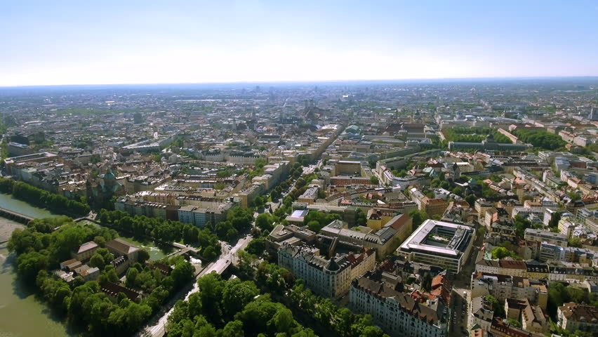 Aerial Video Flying By Over Munich City Center feat. Isar River around Beautiful Old Historical Town Buildings and Iconic Landmarks in Germany 4K UHD
