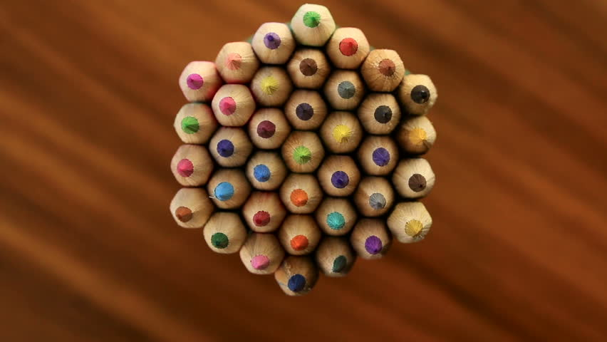 Many multicolored pencils move in a circle on a black wooden background. Concept office or school, knowledge day, the first of September. Video footage is spinning rotate | Shutterstock HD Video #27606127