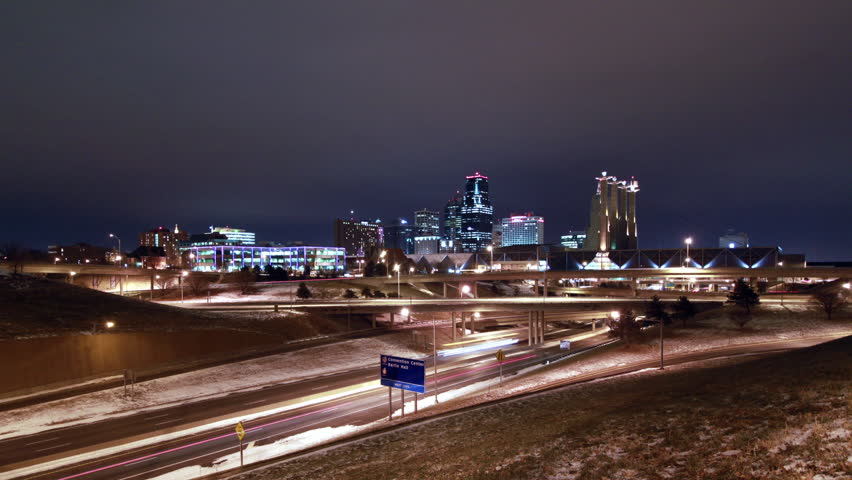 A time-lapse of the Kansas City skyline at night during the inter with light snow on the ground
