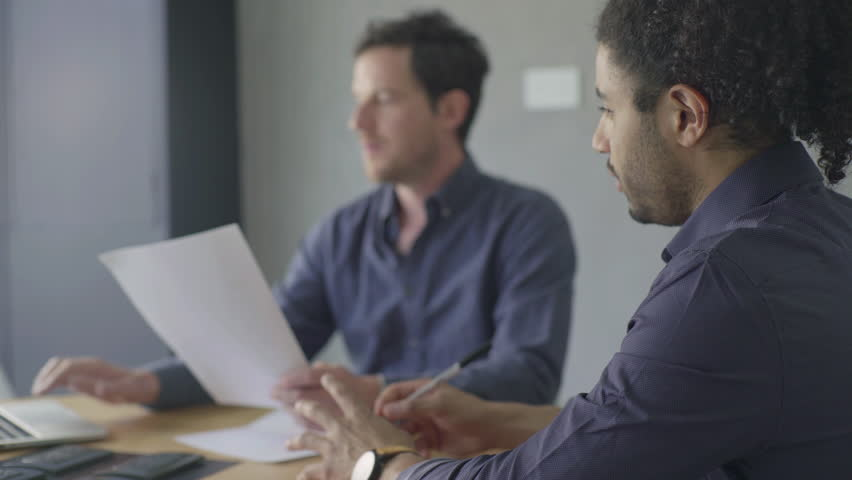 Business colleagues reading document | Shutterstock HD Video #27627649