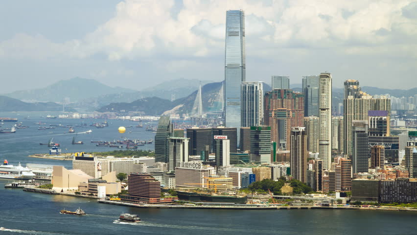 HONG KONG - AUGUST 6: Time lapse of Hong Kong Victoria Harbor and Kowloon