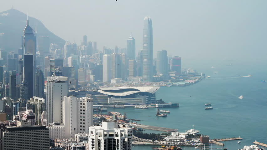 Hong Kong island skyline and pair of eagles flying over the city.