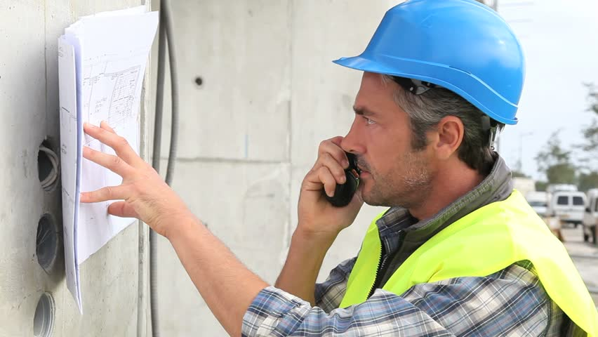Construction manager reading construction plan on site | Shutterstock HD Video #2767919