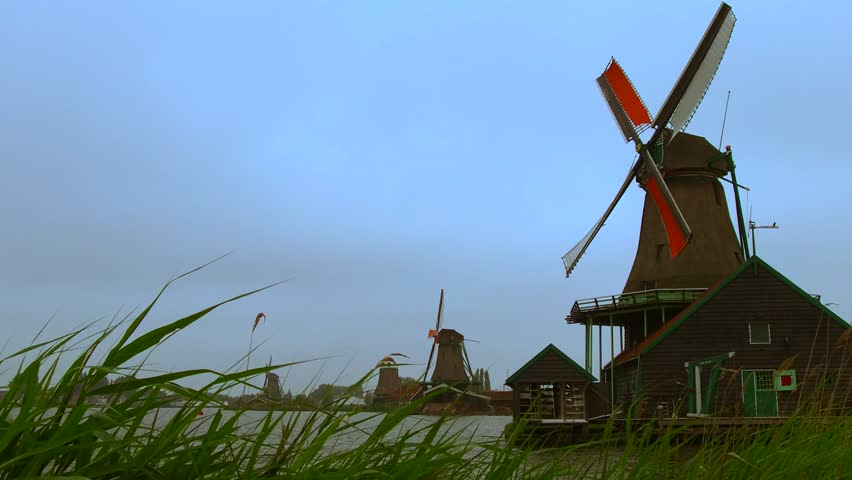 """Volendam is a town in North Holland in the Netherlands with historical windmills, """"smock mills"""" usually used to mill grain - The smock mill consists of a tower, usually with six or eight sides"""