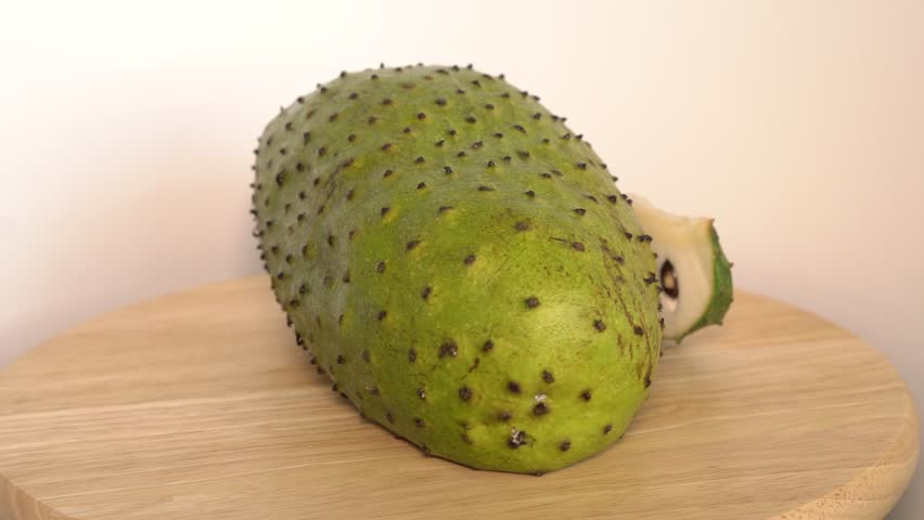 Soursop, Prickly Custard Apple with slice rotate on wooden cutting board