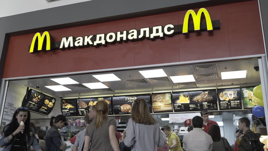 MOSCOW, RUSSIA - 23 MAY 2017: People buy food and drinks in McDonald's