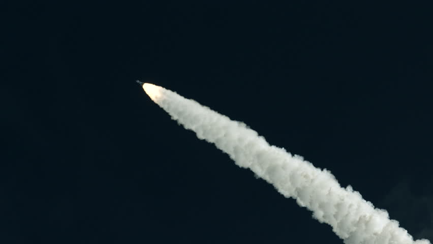 Space rocket launch from Kennedy Space Center, Florida in super slow motion - dark sky and smoke