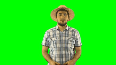 4K Tourist Man Looking with Monoculars Around and Natural View with a Hat Sombrero On Green Screen Chroma Key . Background High Resolution Binocular with Shirt
