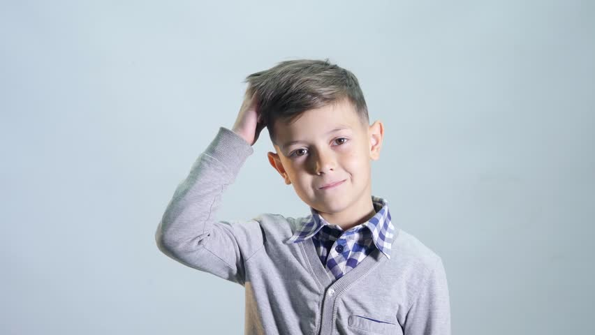The boy scratches his hair and thinks up. | Shutterstock HD Video #27778486