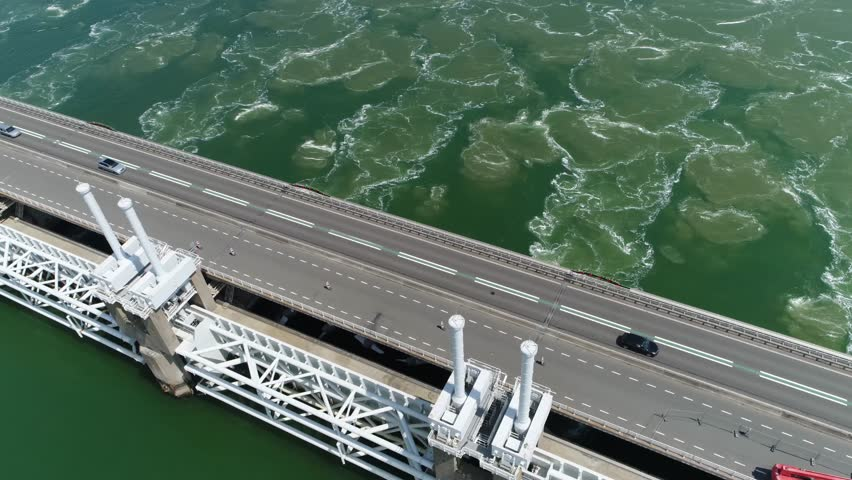 Aerial camera panning down over Oosterscheldekering is largest of the 13 ambitious Delta Works series of dams and storm surge barriers designed to protect the Netherlands from flooding from North Sea