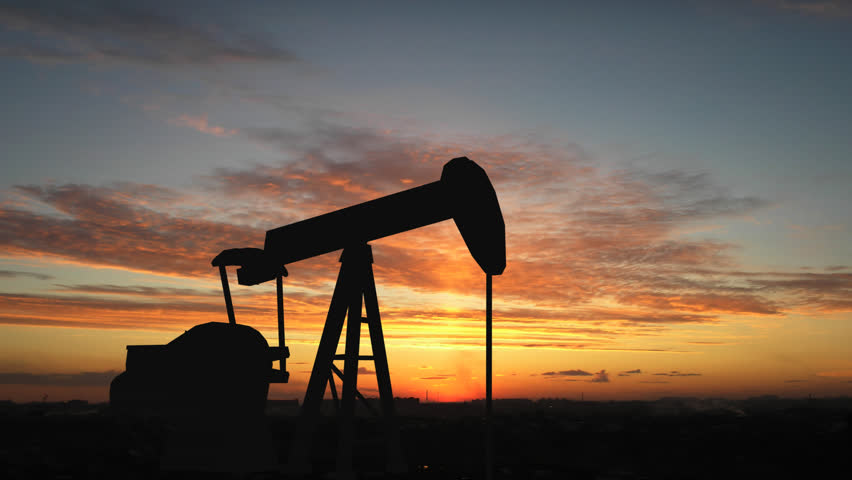 Oil pump over sunrise