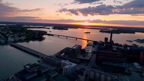 Scenic sunset evening with two bridges, power plant and sea view at the Ruoholahti towards Seurasaari and Salmisaari in Helsinki, Finland