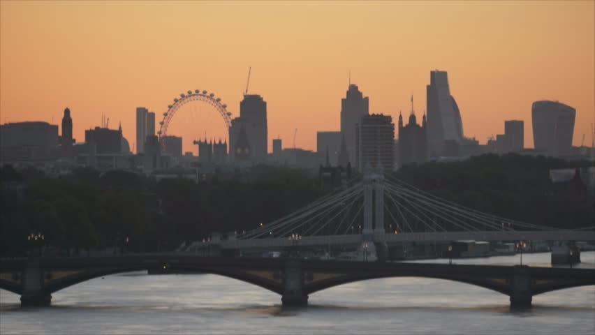 Sunrise timelapse over London skyline, high summer. View east along the Thames from Chelsea Harbour.