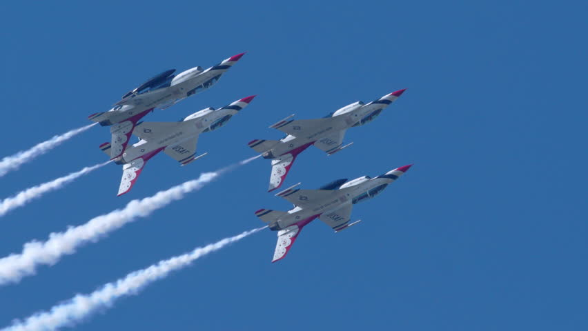TITUSVILLE, FLORIDA - CIRCA MARCH 2017: USAF Thunderbirds Demonstration Team performs at airshow - four F18 Hornet jets flying upside down in super slow motion