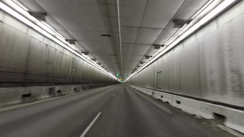 DILLON, COLORADO - 2 JUN 2017: Colorado Eisenhower Tunnel inside drive POV fast motion. Edwin C. Johnson Memorial Tunnel on I-70 crosses under the continental divide in the Rocky Mountains.
