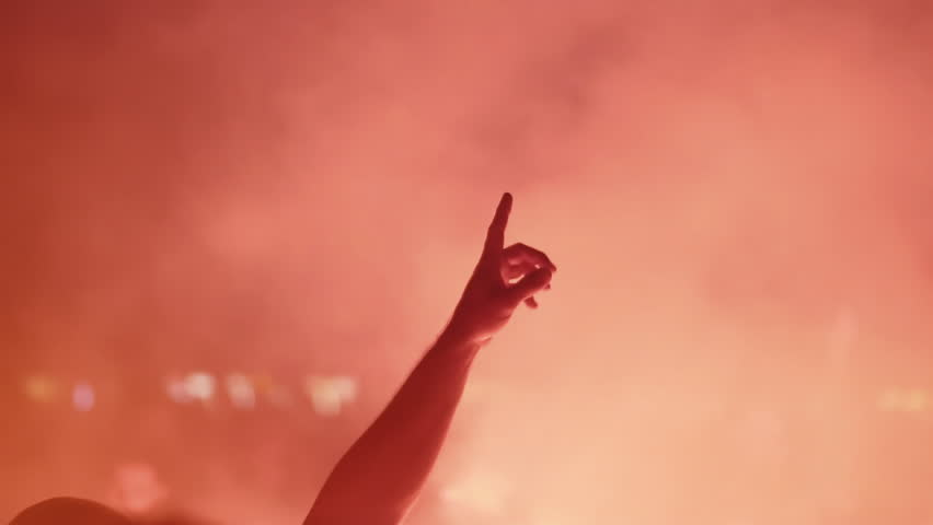 Hands in the air at an outdoor wild night party with lights and smoke 100fps