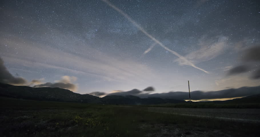 Time lapse of stars, mountains and clouds in Campo Imperatore. Abruzzo, Italy   Shutterstock HD Video #27906619