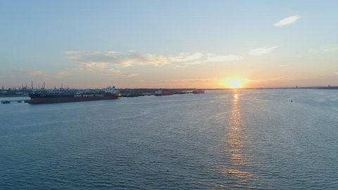 Aerial View of Cargo Ships at Sunset Docked in Southampton, UK