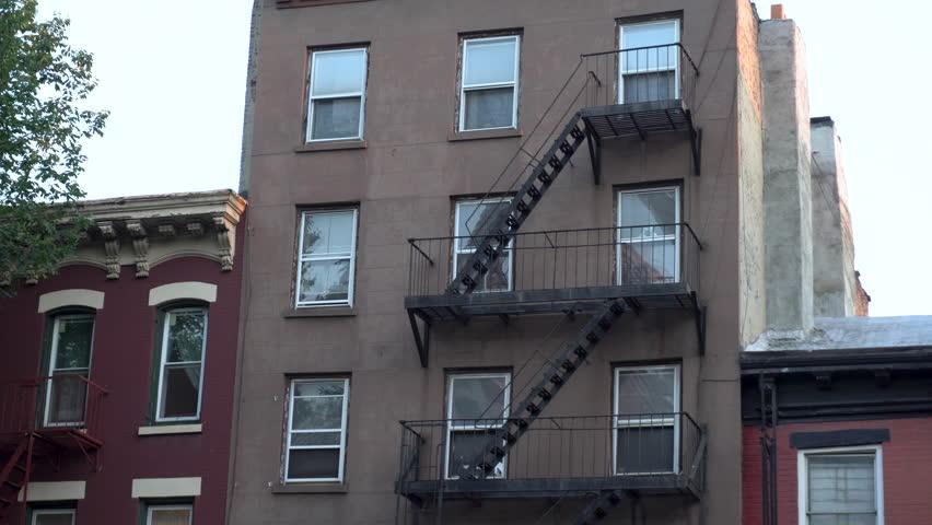 Apartment Building Exterior exterior wide establishing shot of a vintage brick office or