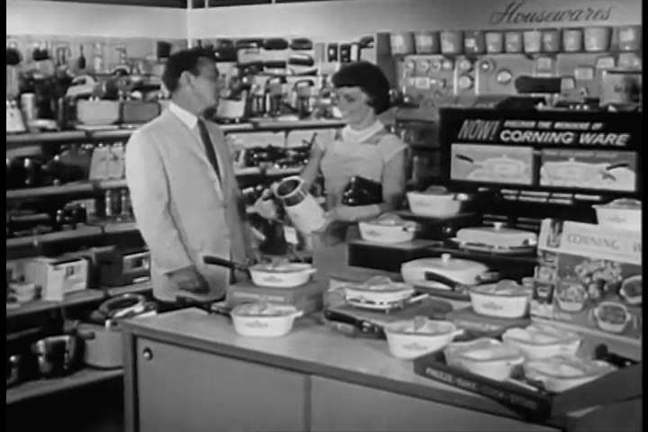 1960s: Women shoppers try out Pyroceram coffee percolators, in a store, in 1960.