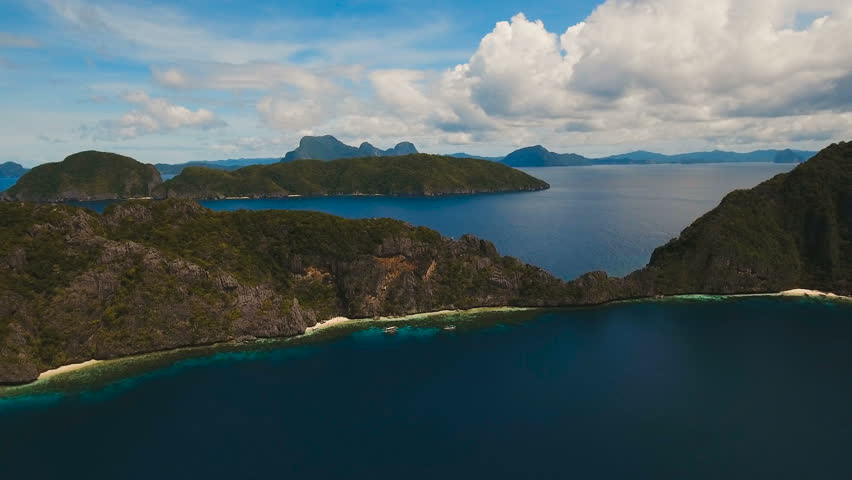 Tropical islands, aerial view. Aerial view: sea and the tropical island. Tropical bay in El Nido. Archipelago El Nido.Sandy beaches of the wild islands. Philippines National Marine Park. Aerial video