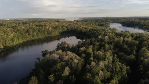An Aerial view of a northern Minnesota chain of lakes. A stunning view of mostly empty lakes with still water and near sunset.