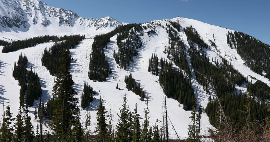 Arapahoe Basin Ski Area resort late spring recreation Colorado. Alpine ski area in the Rocky Mountains west of Denver. Loveland Pass road on Continental Divide. Destination for sports and recreation.