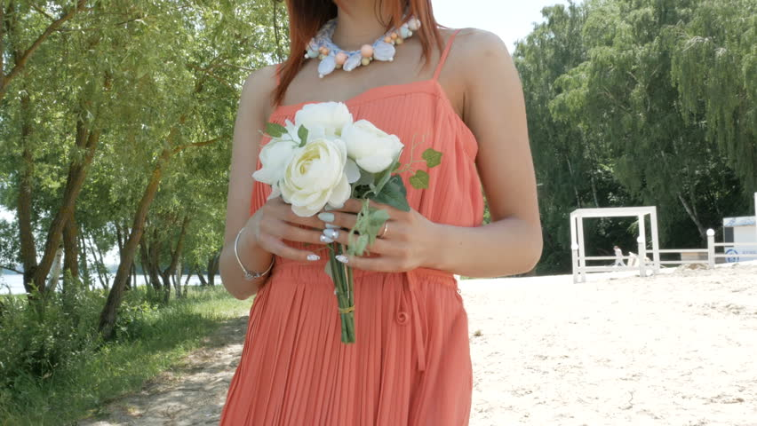 Young beautiful woman holding a bouquet with white flowers | Shutterstock HD Video #28025293