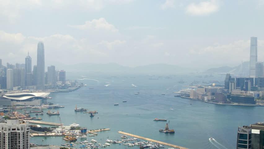 Hong Kong Harbor panorama cityscape - Central District, Victoria Harbor, Victoria Peak, Hong Kong Island and Kowloon, Hong Kong. | Shutterstock HD Video #2803519