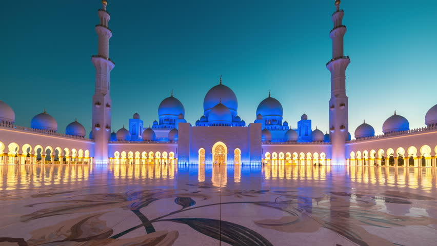 ABU DHABI, UAE - MAY 2017: Panoramic timelapse of Sunset in Sheikh Zayed Mosque in Abu Dhabi, United Arab Emirates. Transition of the day at night