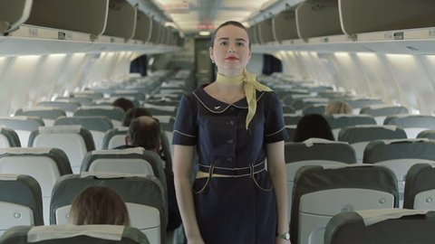Stewardess gives the instructions of safety in case of crash airplane