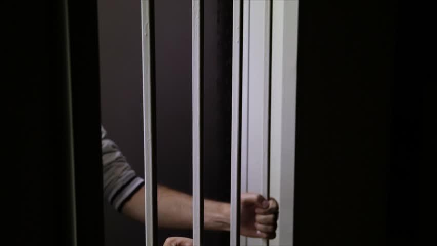 Convict behind bars