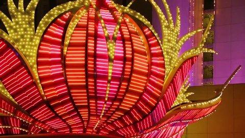 Las Vegas Neon Lights. Neon flashing lights of Las Vegas Casino. Flashing neon light on the famous Las Vegas Strip. Red Neon Flashing Illuminated Bulbs.