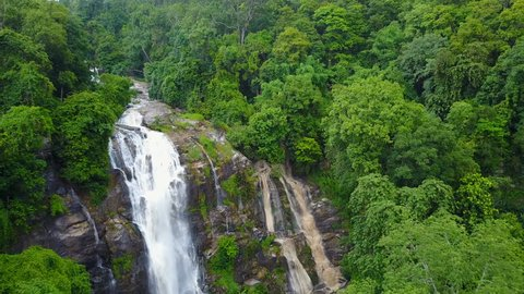 Aerial view of Wachirathan waterfall with spray of water Splashing one of the famous waterfall at Doi Inthanon National Park mountain. Located in Chiang Mai, Thailand.