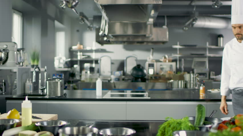 Restaurant Kitchen Window minsk -january,7,2015 chefs preparing food in the kitchen