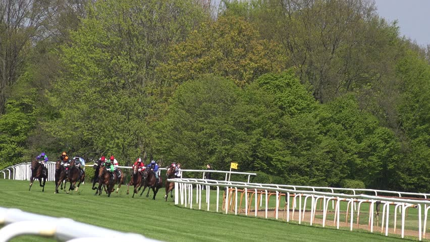 Hannover, GER, 1 Mai 2016, 4k Horse racing final run after kast curve jockeys passing by close up / 4k Horse racing final run after kast curve jockeys passing by close up
