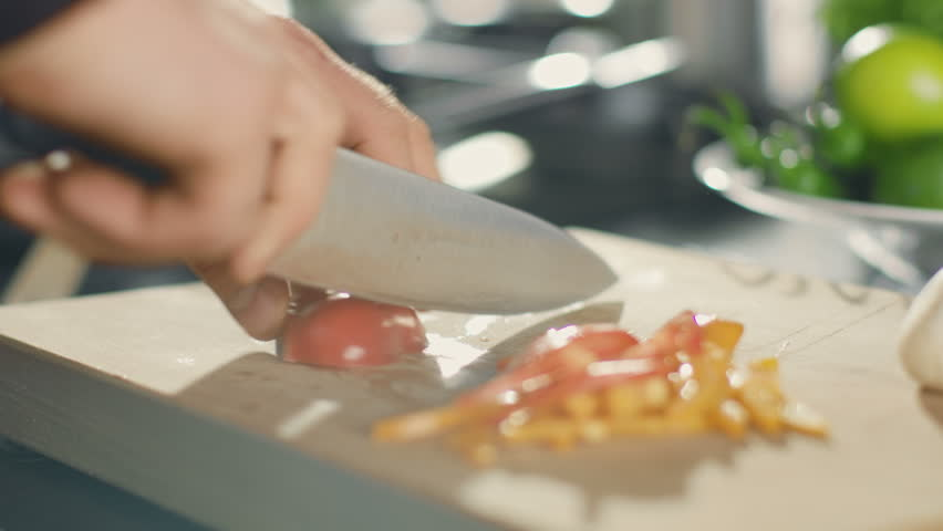 Close-up of a Chef Masterfully Cutting Colorful Vegetables on Cutting Board. Tomatoes and Mushrooms. Shot on RED EPIC-W 8K Helium Cinema Camera.