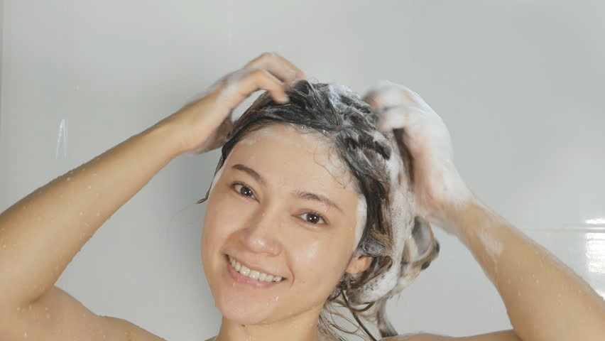 4K Of Young Woman Taking A Shower And Washing Hair With -3684