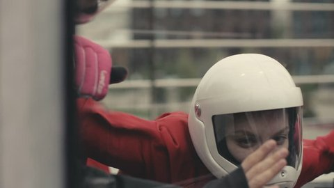 Woman skydiver flying in wind tunnel close up. Woman skydiver skydiving in an indoor arena. Indoor skydiving wind tunnel.. Indoor skydiving wind tunnel. Extreme parachuting