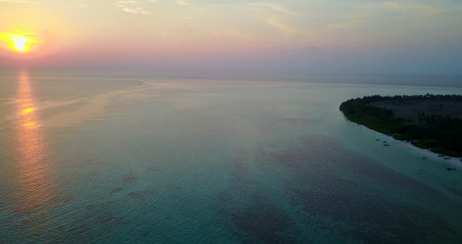 V04942 Aerial flying drone view of Maldives white sandy beach on sunny tropical paradise island with aqua blue sky sea water ocean 4k   Shutterstock HD Video #28220653