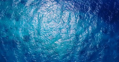 v06831 Aerial flying drone view of Maldives white sandy beach abstract waves water surface texture on sunny tropical paradise island with aqua blue sky sea ocean 4k