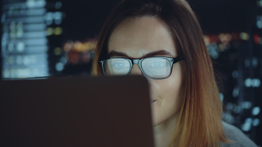 Closeup of young woman using computer touchscreen, hipster girl using digital tablet device touchscreen wearing glasses, busy female freelancer working at home via laptop | Shutterstock HD Video #28294069