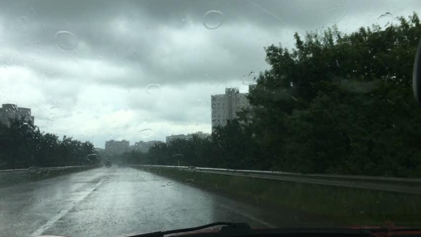 Car rides in heavy rain | Shutterstock HD Video #28297819