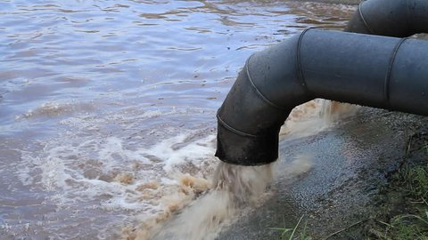 Dirty water flows from a pipe
